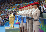 EMIRATES---Emirates-Cabin-Crew-line-up-with-the-2014-FIFA-World-Cup-winners-medals-ready-for-the-pre